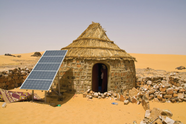 08 Apr 2010, Algeria --- Traditional house with a solar panel in the Sahara Desert, Algeria, North Africa, Africa --- Image by  </p> 